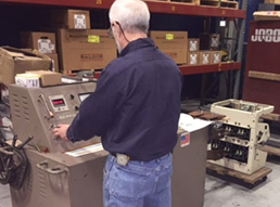 Technician performing final testing of breaker prior to delivery and installation at customer site.